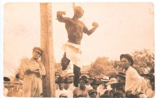 Postcard_of_the_lynched_Jesse_Washington_front_and_back-e1422385278498.jpg